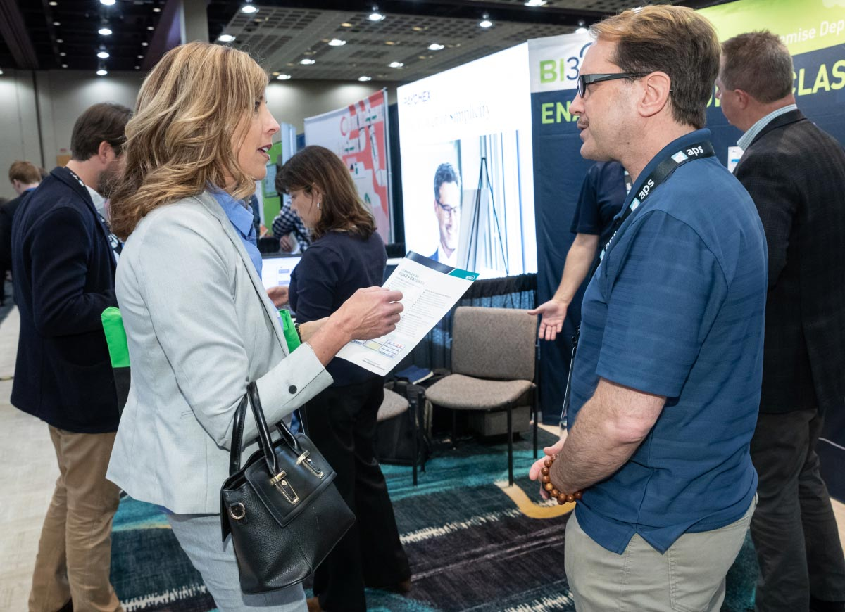 Sage Intacct Advantage - two people talking at a booth