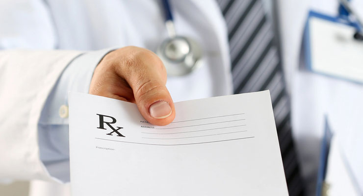 Doctor passing a sheet