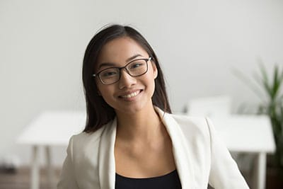 Asian female smiling - chest up photo - HR Team
